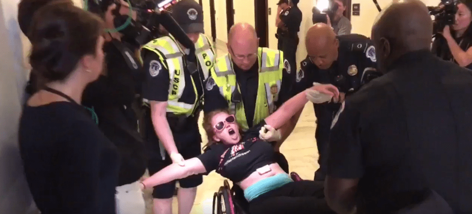 Protesters dragged from wheelchairs raise thousands to cover legal fees following arrest