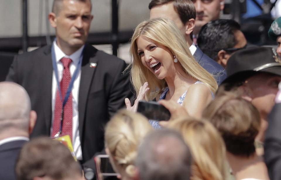 Ivanka Trump smiles and waves as she arrives  in Warsaw, Poland