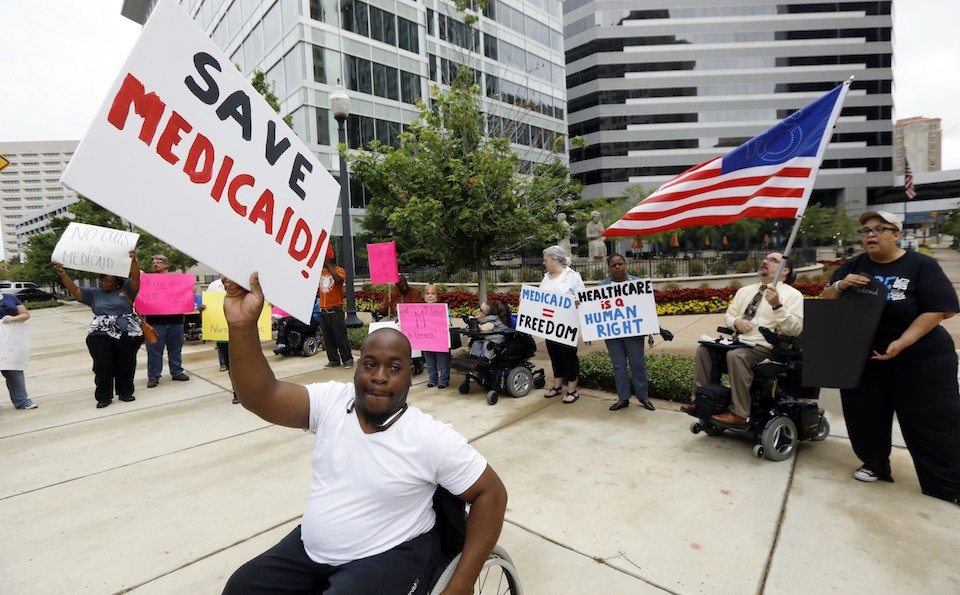 Medicaid recipients and their supporters stage a protest outside the building that houses the offices of Sen. Thad Cochran (R-MS)
