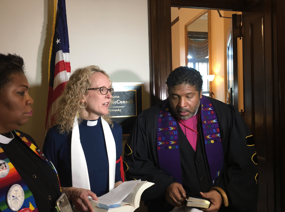 Clergy protest the GOP's health care bill outside Mitch McConnell's office