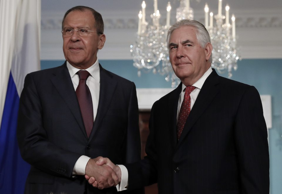 Secretary of State Rex Tillerson, right, shakes hands with Russian Foreign Minister Sergey Lavrov