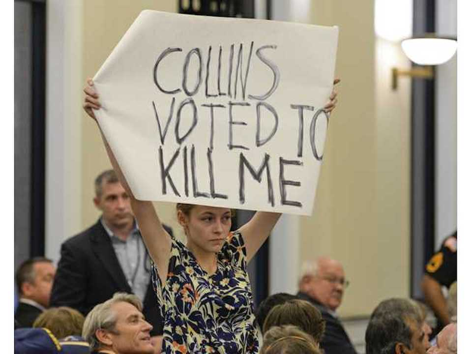 A protester at a town hall in the reddest district in the country, with a strong message