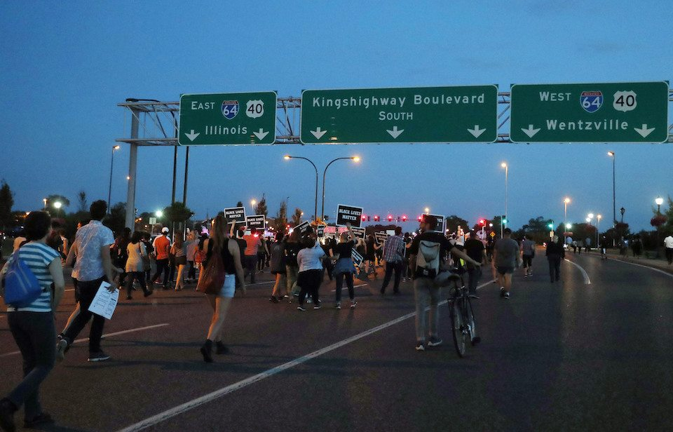 Protesters march down a highway in downtown St. Louis, after a judge found a white former police officer not guilty of first-degree murder in the death of a black man