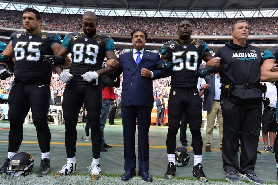 Jacksonville Jaguars owner Shad Khan joins arms with his team in protest of Trump's attacks on free speech