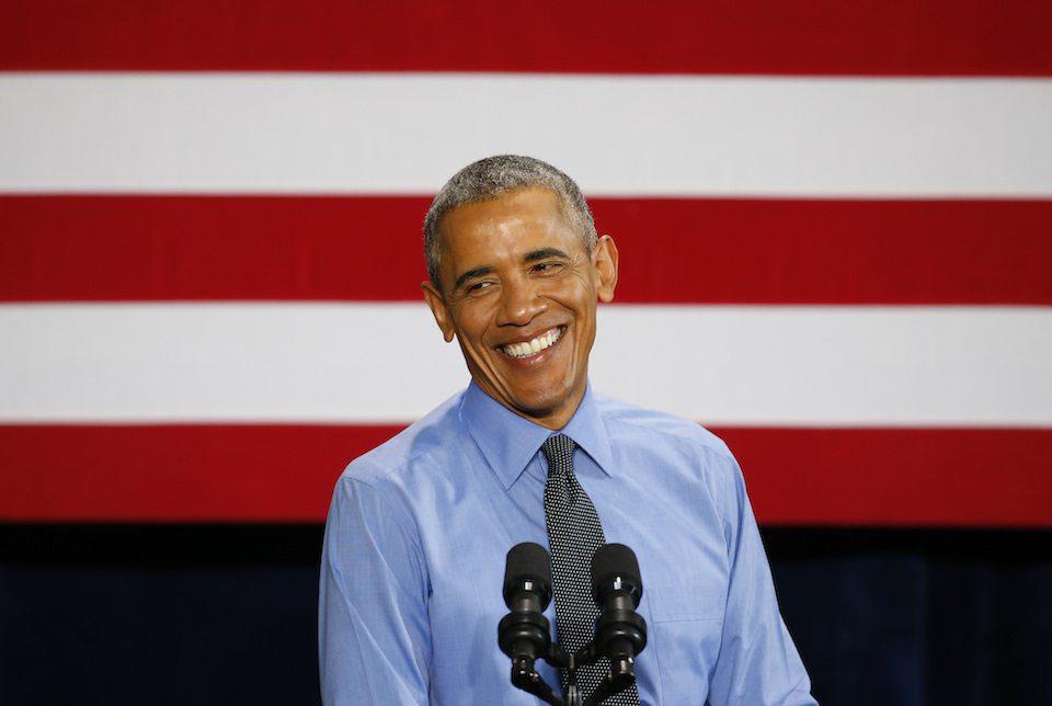 Barack Obama smiles flag