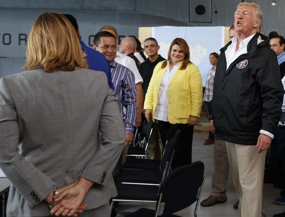 Donald Trump continued his abominable treatment of San Juan Mayor Carmen Yulin Cruz (left, in gray) at a briefing in Puerto Rico