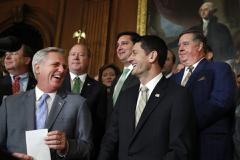 House Majority Leader Kevin McCarthy of Calif., and House Speaker Paul Ryan of Wis., laugh during a statement by House Republicans to the media following a vote