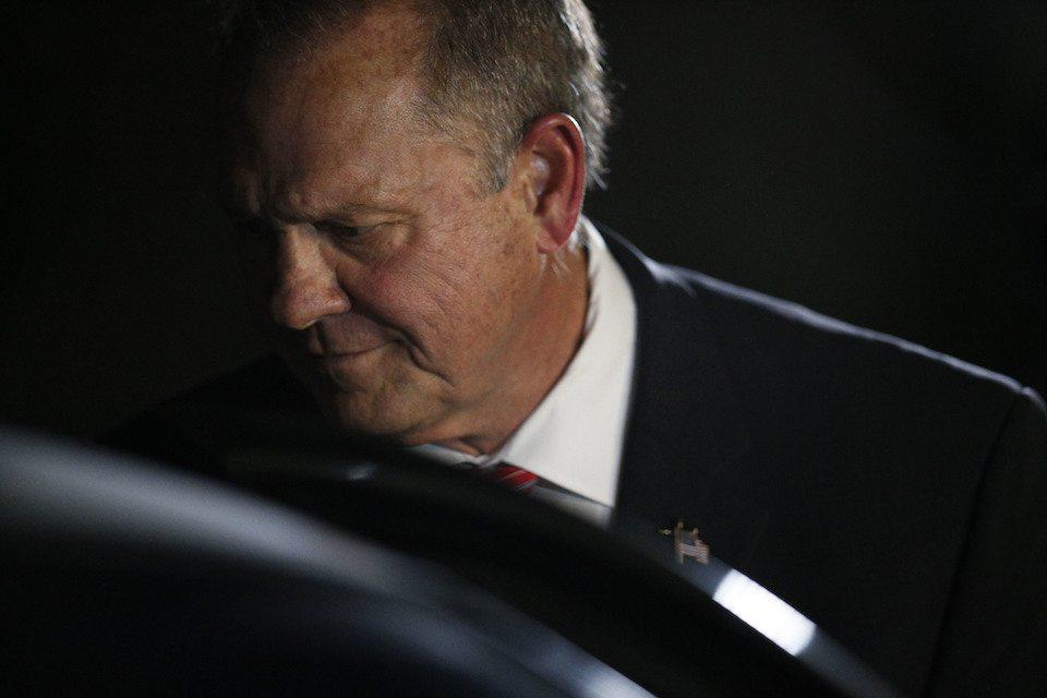 Former Alabama Chief Justice and U.S. Senate candidate Roy Moore gets in his car after he speaks at a revival, Tuesday, Nov. 14, 2017, in Jackson, Ala. (AP Photo/Brynn Anderson)