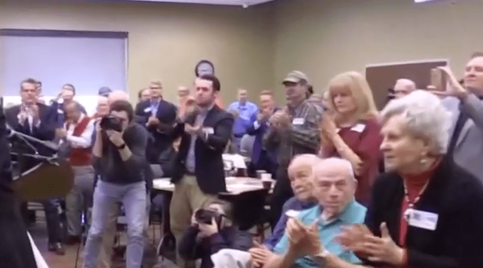 Applauding audience at Roy Moore event