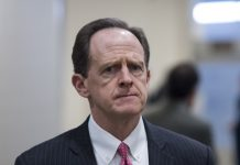 Sen. Pat Toomey, R-Pa., arrives in the Capitol for the Senate Republicans' policy lunch on Tuesday, Jan. 23, 2018.