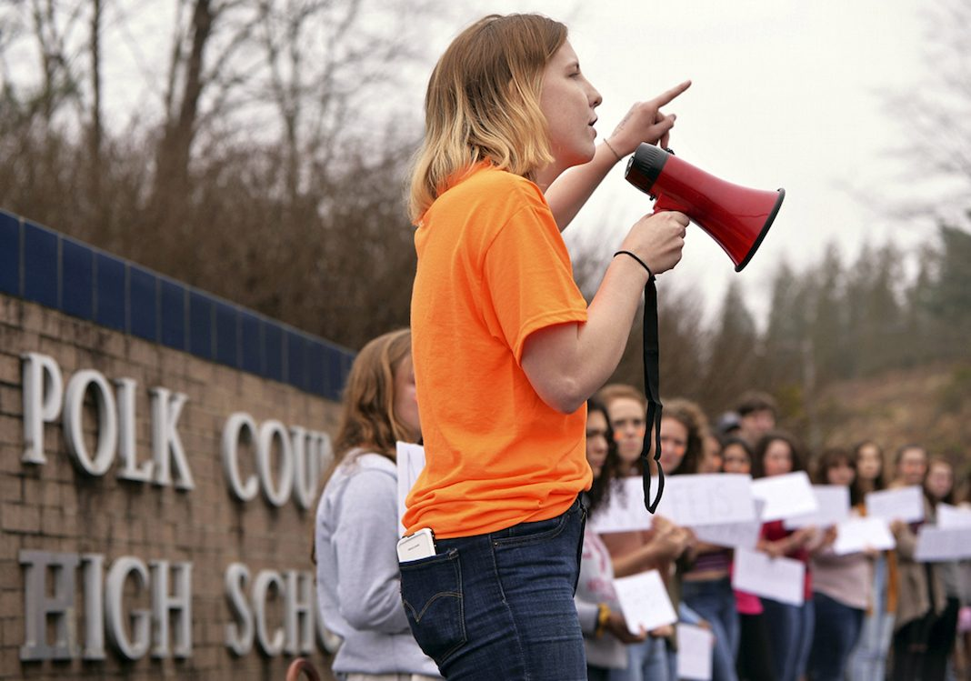 Around 50 Polk County High School students participated in a walk-out from school on Tuesday morning, February 20, 2018. The students, including senior Emily Hogan, center, protested the epidemic of mass shootings in American schools, speaking in front of the school's sign along Hwy. 108 in Columbus as supporters cheered them on.