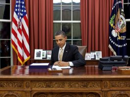 President Obama working in the Oval Office