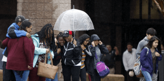 Students wait outside Dalton High School in Georgia after a shooting incident