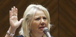Sen. Debbie Lesko, right, R-Peoria, speaks about SB1257, a bill allowing concealed-carry permit holders to take firearms into some public buildings, on the Senate floor at the Arizona Capitol Wednesday, May 4, 2016, in Phoenix. The bill was rejected on a 14-14 vote, but could come back under reconsideration rules.