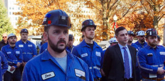 A group of coal miners listens to speakers at a pro-coal rally, Tuesday, Nov. 28, 2017, at the state Capitol in Charleston, W.Va. The rally came during a break in a public hearing on the Trump administration's planned repeal of an Obama-era plan to limit planet-warming carbon emissions.
