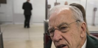 Senate Judiciary Committee Chairman Chuck Grassley, R-Iowa, whose panel is investigating Russian meddling in the U.S. elections, listens to a reporter's question about the case as he boards a tram between the Capitol and the Senate office buildings following final votes, in Washington, Thursday, Dec. 14, 2017. Some House Republicans ratcheted up criticism of special counsel Robert Mueller's probe into Russian meddling Wednesday, questioning whether there was bias on his team of lawyers but stopping short of calling for his firing or resignation.