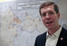 Democrat Conor Lamb, stands in front of the map of the congressional district he is running to represent while at a campaign office, Wednesday, March 7, 2018 in Carnegie, Pa. Lamb is running against Republican Rick Saccone in a special election being held on March 13 for the PA 18th Congressional District vacated by Republican Tim Murphy.
