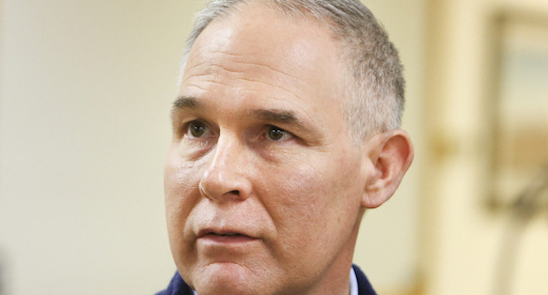 EPA Administrator Scott Pruitt talks with local media following a press conference after taking a tour of the Black Thunder coal mine outside of Wright, Wyo., Thursday, Mar. 29, 2018.