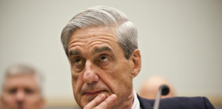 Special counsel Robert Mueller listens as he testifies on Capitol Hill in Washington
