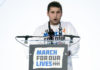"""Alex Wind, a survivor of the mass shooting at Marjory Stoneman Douglas High School in Parkland, FL, speaks during the """"March for Our Lives"""" rally"""