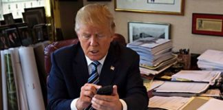 Donald Trump on his phone
