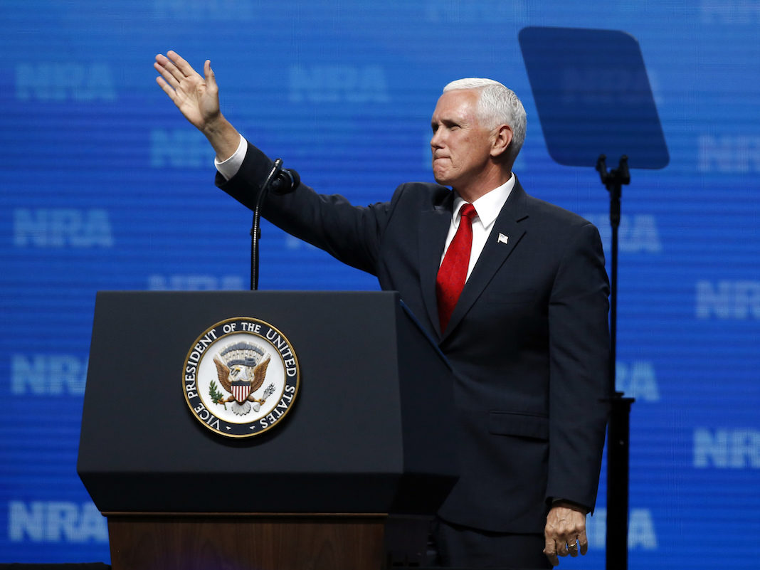 Mike Pence waves after speaking at the National Rifle Association Leadership Forum