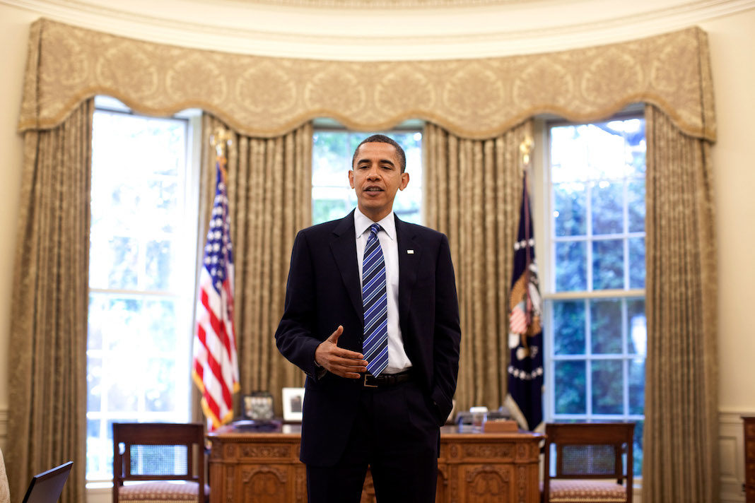 President Barack Obama prepares for a speech in the Oval Office, June 9, 2009.