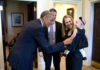 President Barack Obama greets departing staff member Lindsay Hayes and family in the Outer Oval Office
