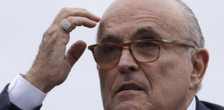 Rudy Giuliani scratches his head.