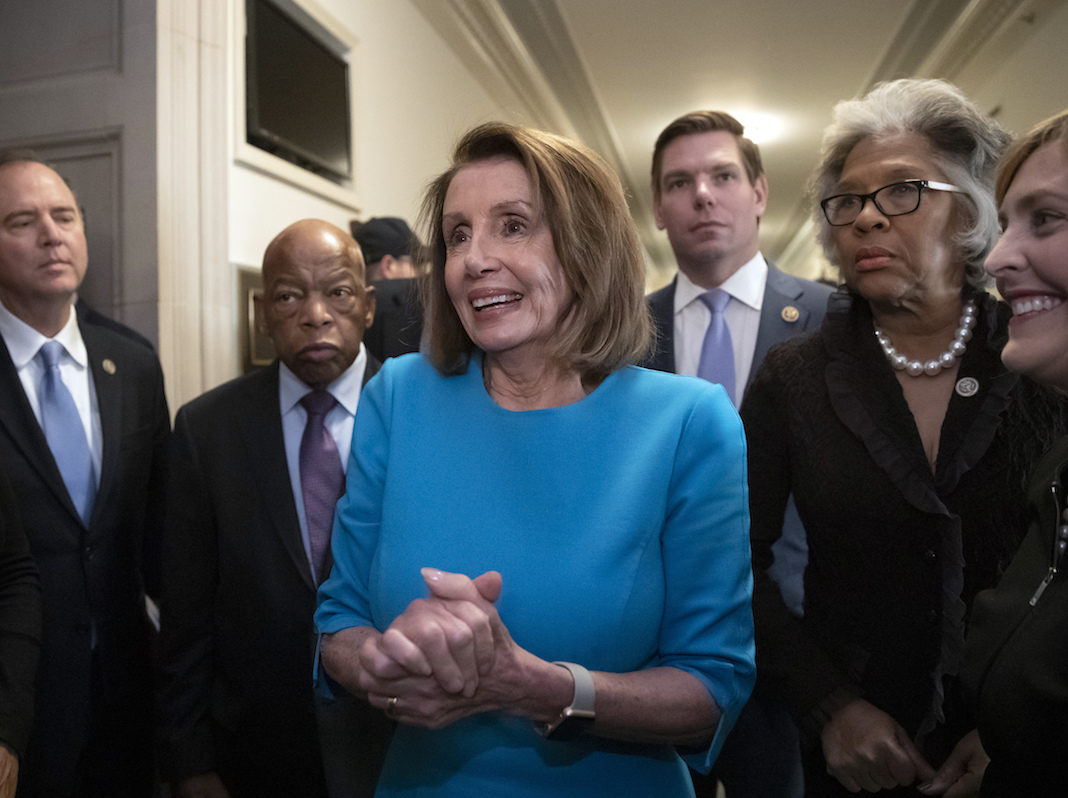 Nancy Pelosi with House Democrats