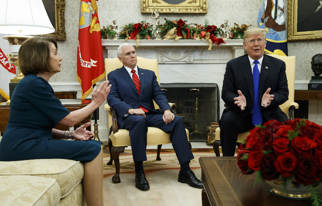 Pelosi, Pence, and Trump in a meeting.