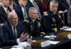 Director of National Intelligence Daniel Coats, left, accompanied by Defense Intelligence Agency Director Gen. Robert Ashley and National Security Agency Director Gen. Paul Nakasone