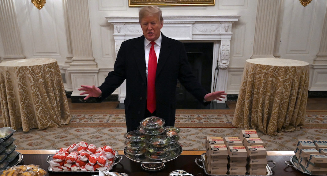 Donald Trump with a table full of fast food