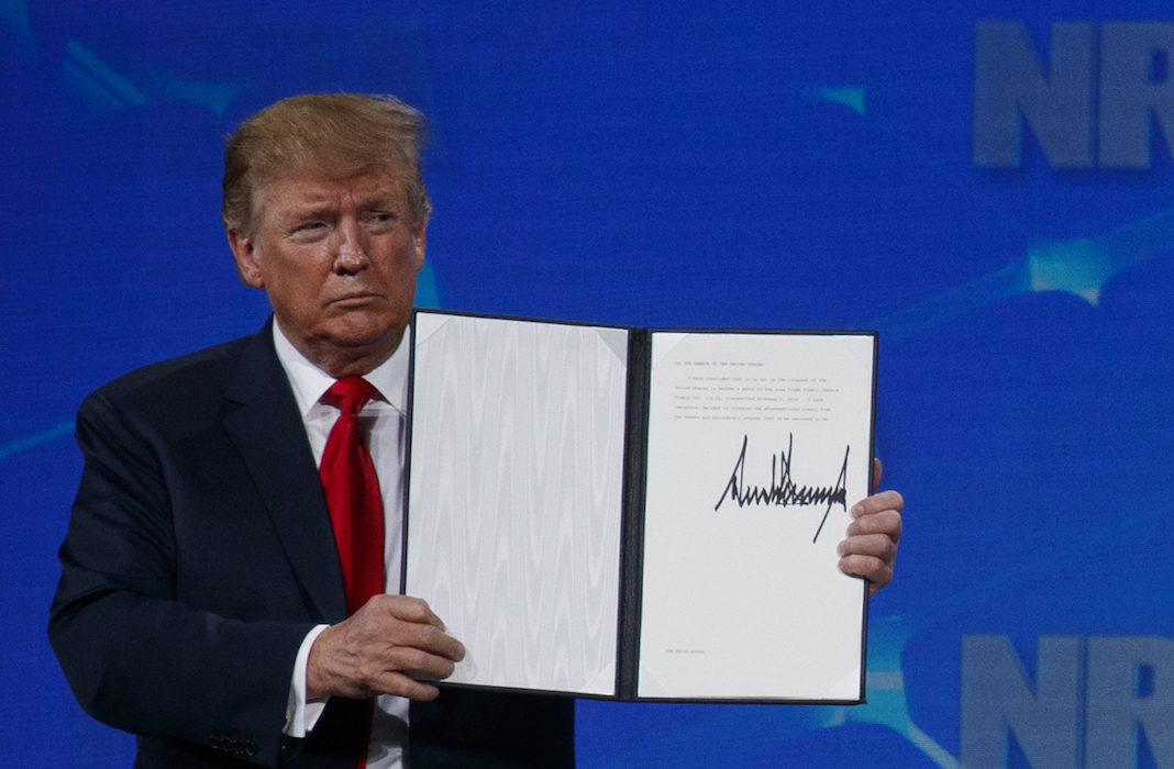 Trump at NRA with signed document
