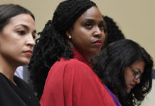 Rep. Alexandria Ocasio-Cortez, D-N.Y., left, Rep. Ayanna Pressley, D-Mass., center, and Rep. Rashida Tlaib, D-Mich.