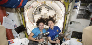 U.S. astronauts Jessica Meir, left, and Christina Koch