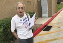 Woman collecting signatures for a ballot measure