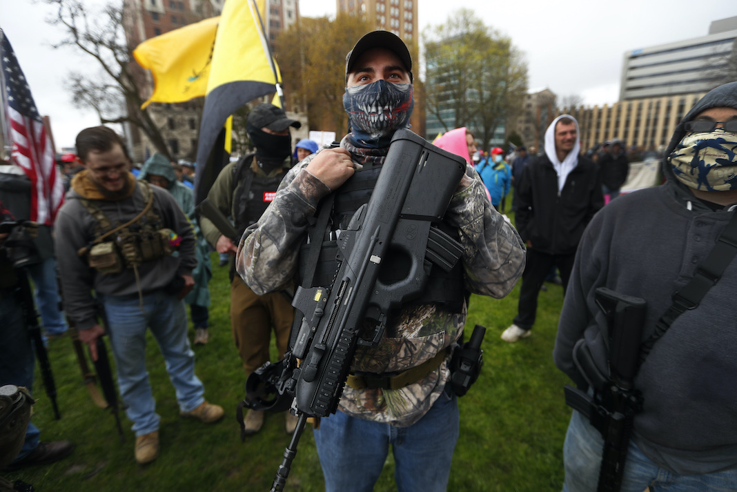 Protester with rifle