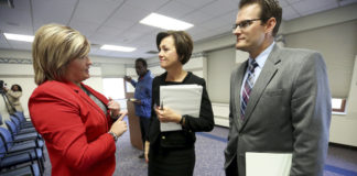 Gov. Kim Reynolds stands with Iowa Republican officials.