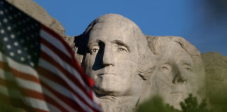 Mount Rushmore and flag