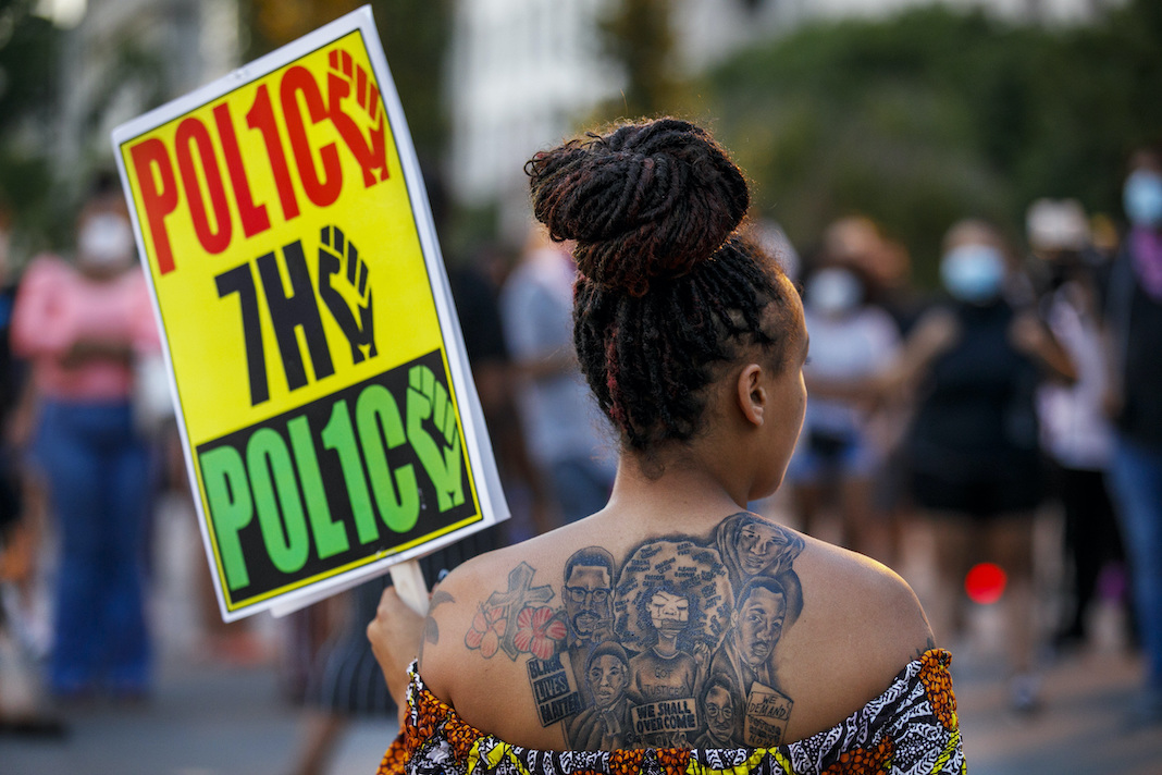 Protester in DC against police violence
