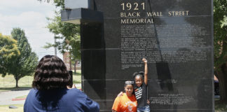 Visitors to Black Wall Street Memorial, Tulsa