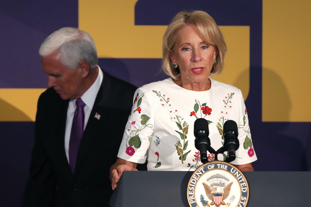 Betsy DeVos with Mike Pence