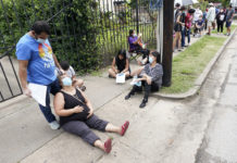 People on line for coronavirus testing