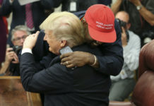 Donald Trump hugs Kanye West.