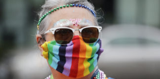 LGBTQ Pride marcher in rainbow mask in Seattle
