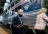 Joe Biden and his wife, Jill, board an Amtrak train.