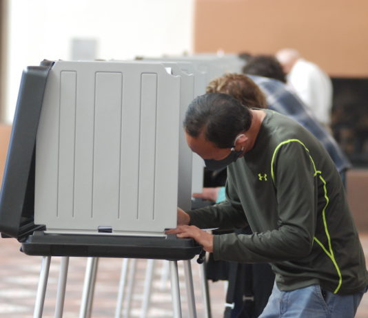 Voters participate in early voting in Santa Fe