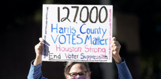 Demonstrator against voter suppression in Houston