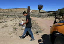 A student carries a book in rural New Mexico